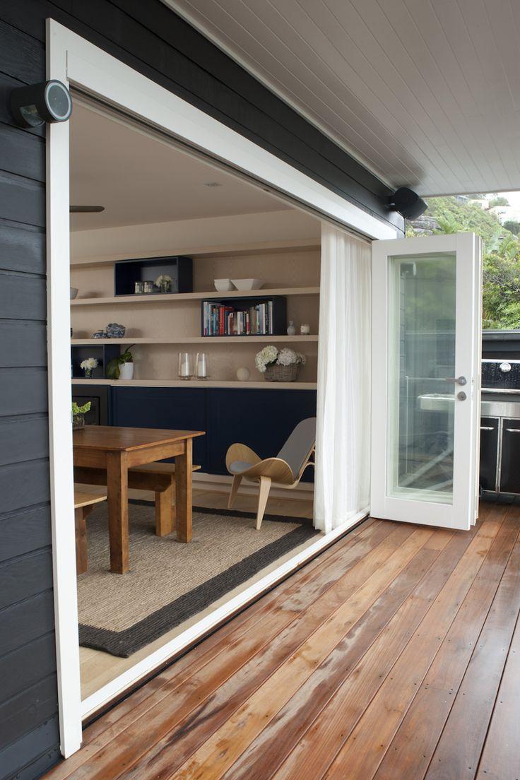 Exterior deck looking in to dining area. Brooke Aitken Design.