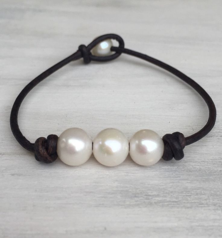 A personal favorite from my Etsy shop https://www.etsy.com/listing/256434554/pearl-on-leather-bracelet-pearls-on