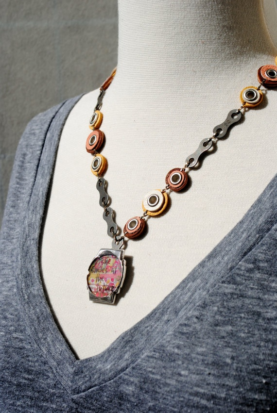 repurposed leather circle & bike chain link by scatterjoythruart, $48.00  For a good cause!