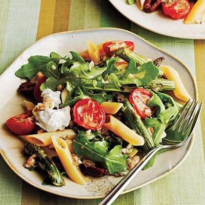 Roasted Asparagus and Tomato Penne Salad with Goat Cheese | Make an upscale pasta salad that's company worthy by combining penne pasta, roasted asparagus, tomato, arugula, herbes de Provence and goat cheese and tossing with a lemony vinaigrette. Serve immediately or cover and chill for 2 hours for a cold pasta salad.