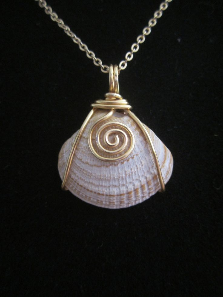 Wire wrapped around a shell pendant, the possibilities are endless with this and all my shells