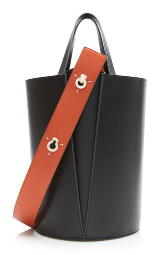 Danse Lente's 'Johnny' bag smooth leather in a geometric silhouette — the label's debut collection was inspired by clean lines of modern architecture. Accented with polished hardware, this style opens to a spacious twill-lined interior that with hold essentials like your wallet, cell and keys.