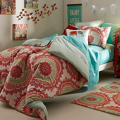 Don't let white walls hold you back. Boost the energy in your room with vibrant bedding to create a warm, bohemian oasis where everyone wants to chill. Choose wall art, pillows, and more that reflect the shades from the bedding for a free-spirited look.