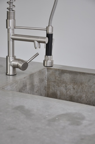 I want a faucet like the one on this concrete kitchen sink