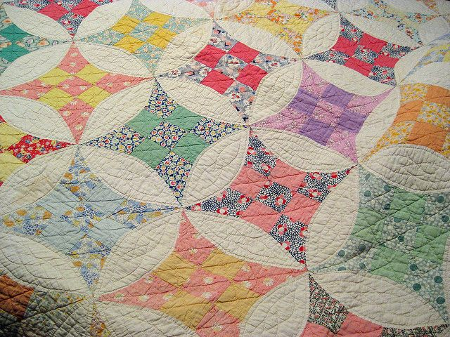 "Great-Grandma made a ""friendship quilt""  Of scraps of calico.  Her neighbors gave small bits of cloth  From each new gown, and so  Great-Grandma fashioned deftly  A quilt of cheerful hues,  And sewed with tiny stitches  The pinks, and grays, and blues.  ~Elizabeth Crawford Yates~~~~ I cannot believe it! This looks almost exactly like my 'Nine Patch' that my paternal grandmother Ruth gave me! She sewed it together in the 1940s."