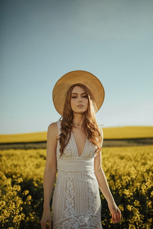 A Wander Through the Wildflowers | HOORAY! Mag | Canola Fields | Lover The Label | Flower Fields | White Lace Gown | Bridal Gown |