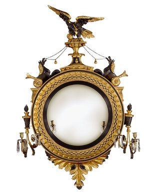 "Regency Eagle & Sea-Horses Girandole Convex Mirror. Carved, Gilt & Ebonised Wood, Brass and Convex Mirrored Glass. England. Circa 1815. 57"" x 36"" (145cm x 92cm)."