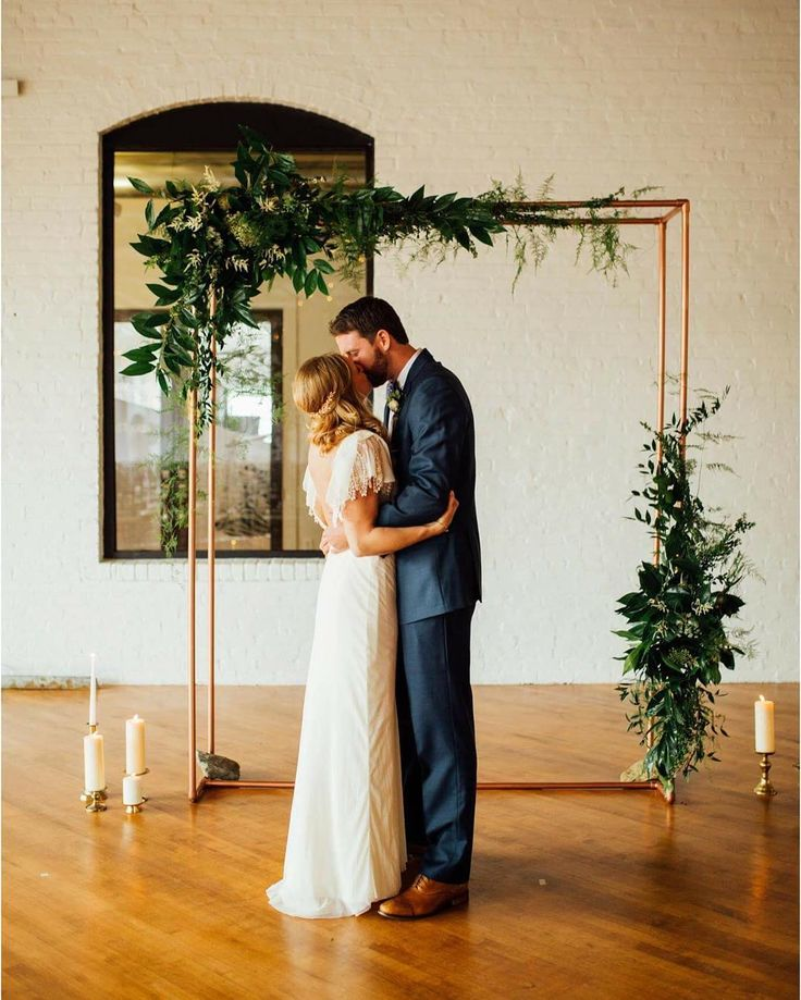 DIY Homemade Copper Piping Ceremony Backdrop with greenery  See Instagram photos and videos from (@love_hunters) My Wedding Ceremony Backdrop.  Photo: Erin Trimble Photography
