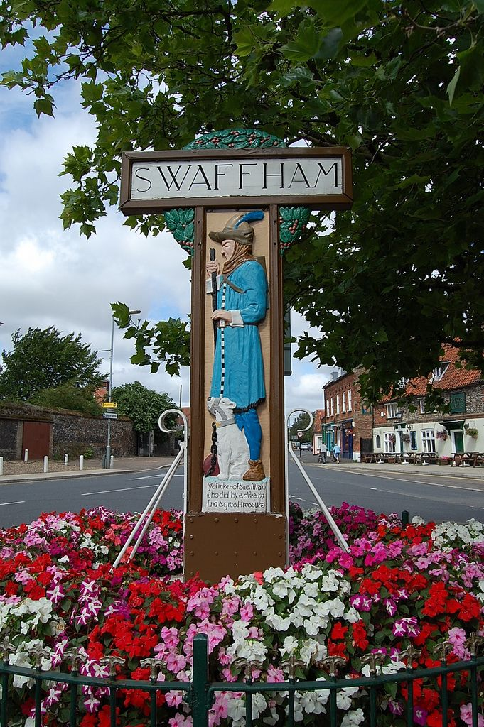 This is transformed into the Market Shipborough Sign in the Kingdom TV series which stars Stephen Fry.  The sign depicts John Chapman, the Pedlar of Swaffham and was carved by Harry Carter (1907-1983)  The Legend of the Swaffham Tinker  John Chapman was a tinker      who lived in Swaffham Town, One night he dreamed a voice did say      if you win win renown, Then he must go to London Bridge,      and there the voice did cry He'd find a man to tell him      where wondrous treasure lies.  So…