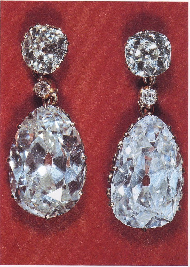 The Queen's Pear Drop Earrings - A set of gold & diamond earrings consisting of two large brilliant diamonds as the studs, below a smaller brilliant followed by a large pear shaped diamond drop. The diamonds were family stones. Diana, Princess of Wales borrowed them from Queen Elizabeth in 1983 during her first official visit to Australia.