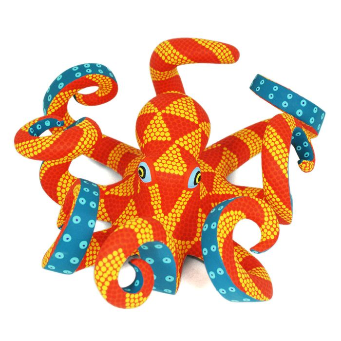 This wonderful polka dot octopus was created by woodcarving artist Saul Aragon. Beautiful tangerine coloring!