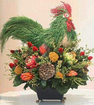 handsome Rooster arrangement is created with fine grasses and floral textures