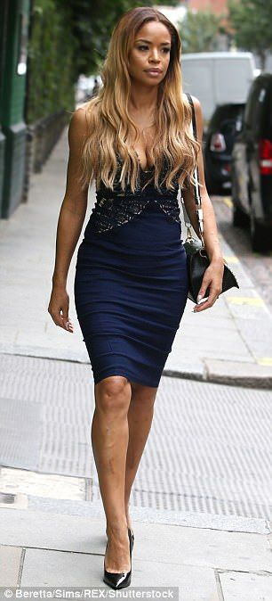 Looking glam! Former Xtra Factor presenter Sarah-Jane looked sensational in a slinky blue dress teamed with metallic heels
