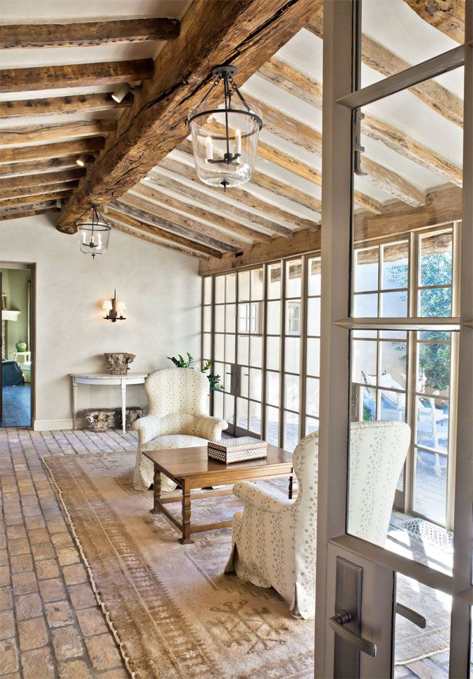 Ok, so I love the idea of a sunroom that is indoors, but has an outdoor feel to it...Antique-reclaimed beams and brick floors; OZ Architects, David Michael Miller interior