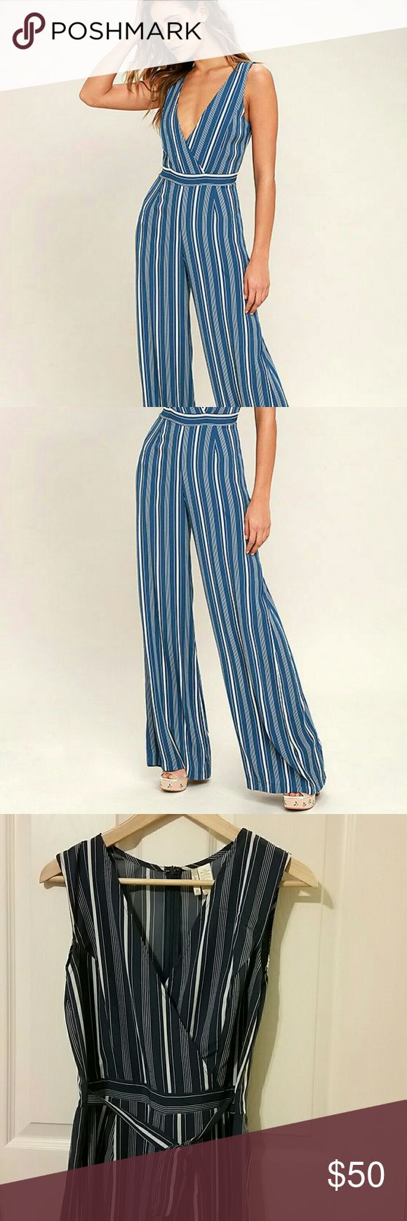 Blue & White Striped Jumpsuit Light and flowy playsuit perfect for your beach vacation. Surplice v neck, wide leg pants with tie waist sash - zipper closure in back. Size medium, new with tags  **not lulu's only listed for exposure, brand is japna Lulu's Pants Jumpsuits & Rompers