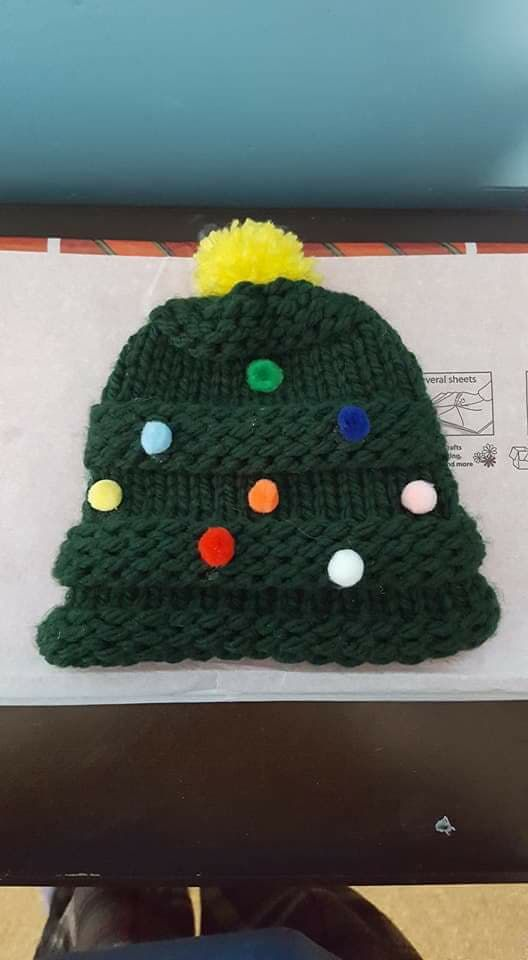 Festive Christmas hat made with KB Loom.