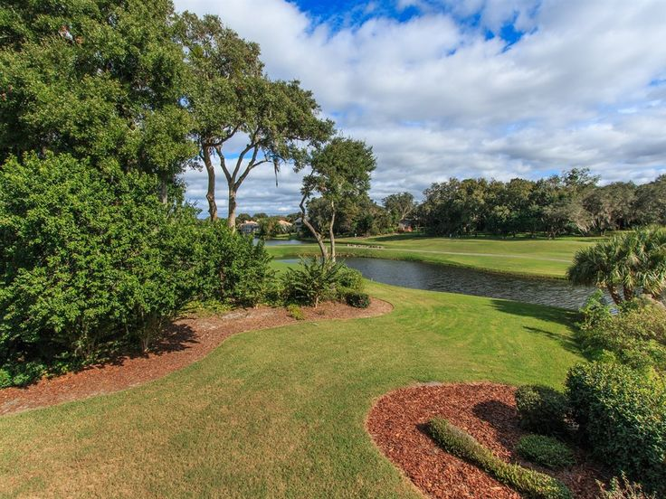 #Home #ForSale Overlooks one of the Bay Hill Golf Courses in #Orlando with Golf and Pond views from charming home that looks like a Southern Living Charmer Listed by #JustinYvonneWiechartLLC with #StarlinkRealty www.FloridaHomeLeader.com #FloridaHomeLeader.com  Photo Courtesy of Justin Yvonne Wiechart, LLC