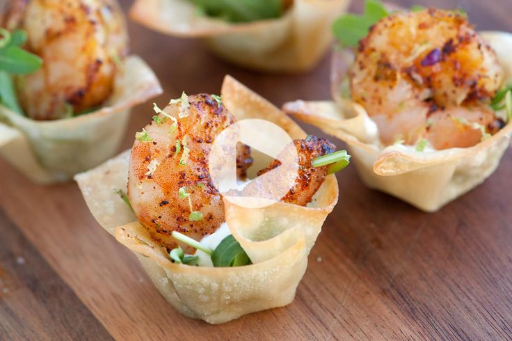 Wonton wrappers are baked in the oven until crisp, filled with arugula, a lime sour cream, and then topped with a big juicy chili-lime baked shrimp.