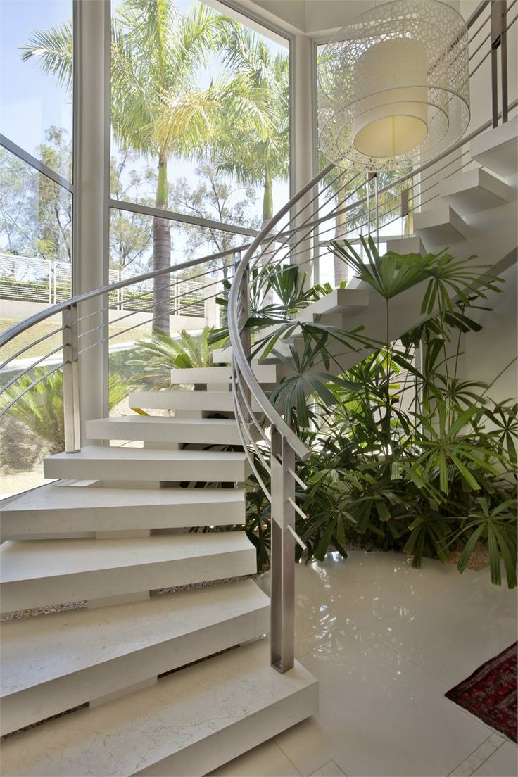 Spiraling open riser staircase with low riser openings and thick treads, 2008, Sao Paulo, Brazil. #stair #interiors #architecture #design