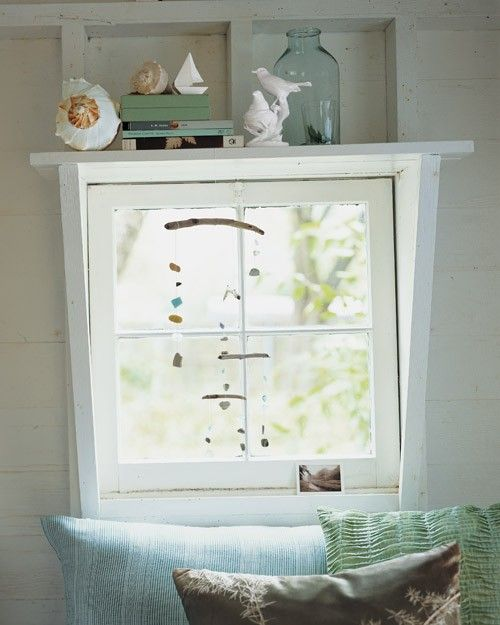 Sea-glass pieces and ceramic shards, another beach find, can be combined in a Calder-esque mobile, producing a charming effect when hung by a window.