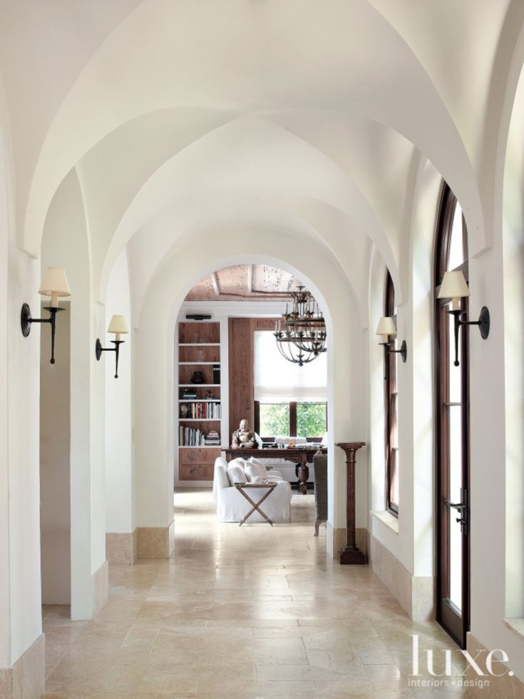 Mediterranean White Hallway with Groin-Vaulted Ceiling