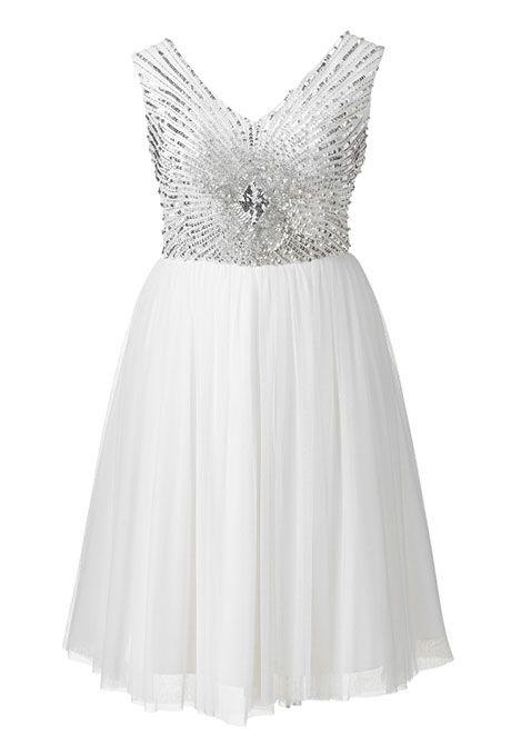 Brides.com: 21 Stylish, Short Plus-Size Wedding Dresses Luxe lace wedding dress, $242, Kiyonna available at SonsiPhoto: Courtesy of Sonsi