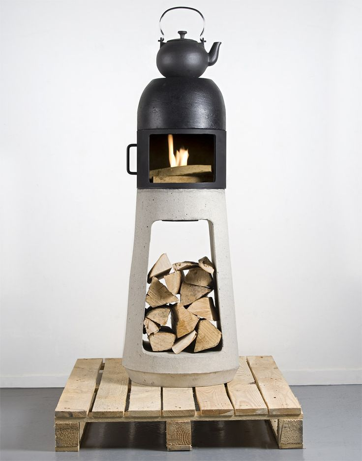 wuehl yanes: wood stove or his graduation project at university in switzerland, he created this little sculptural stove, that could fit into a room, for a cosy fire place atmosphere.  You can either leave the stove closed or open, to either use it as a heater or a fire place. The base, made of concrete,   is used to store the wood. the smoke evacuation is placed at the back so that the top could be flat, which allows   a surface to place a teapot or a pan filled with water for air humidity.