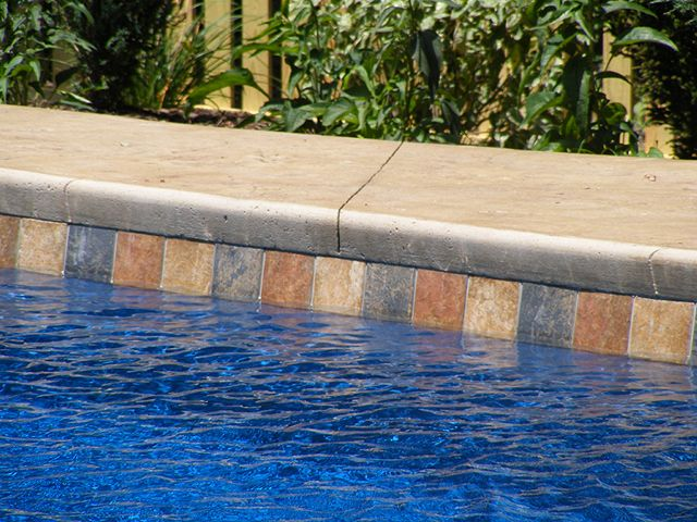 Pool waterline tile ideas waterline tiles aztec for Swimming pool tile pictures