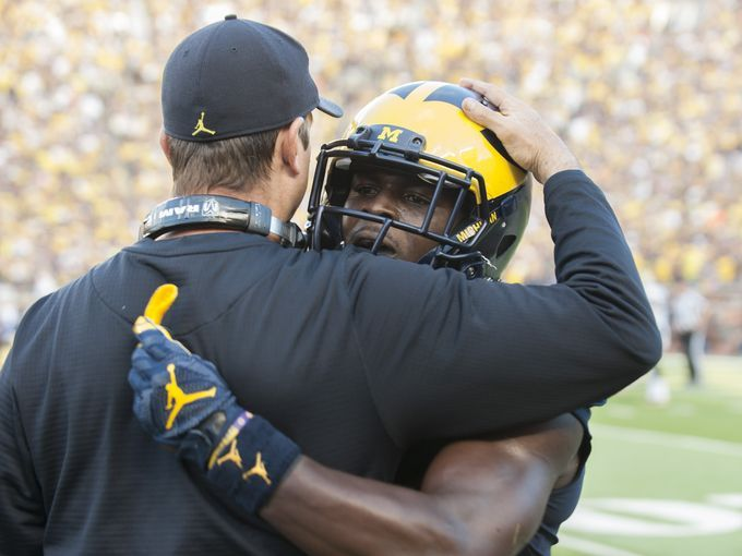 Jabrill Peppers hugs Michigan coach Jim Harbaugh