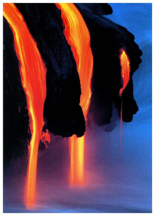 A postcard of lava flowing into the ocean at Hawaii Volcanoes National Park