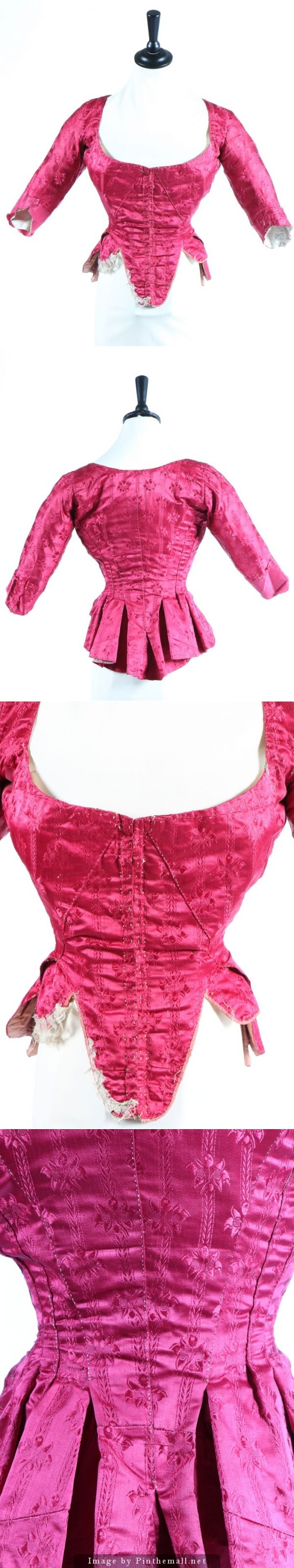 A wine damask satin lady's bodice, 1770s. with foliate self-stripe, tabbed ribbon-bound hem, lined in linen and silk. KTA
