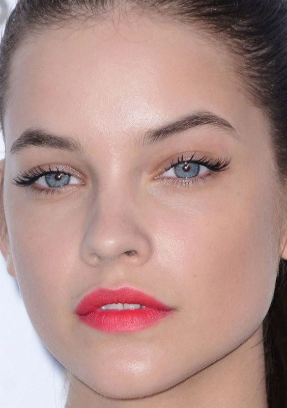 Get her look! Soft black lashes - try Lily Lolo Vegan Mascara. Reddish pink stained lips - try RMS LipShine in Sacred