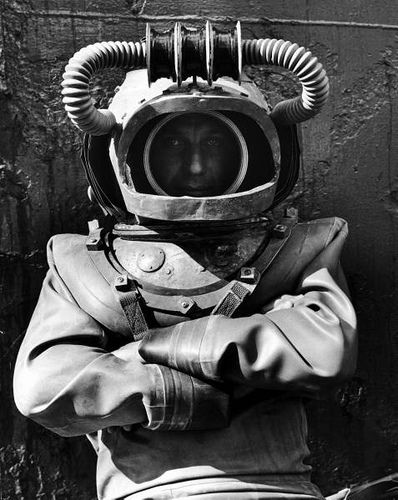 """Richard Fleischer, in diving suit during filming of """"20,000 Leagues Under the Sea"""""""