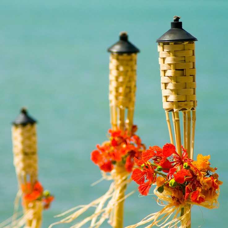 tiki torches with flamboyant    [Destination wedding design by www.suncelebrations.com :: images courtesy www.qstudiovi.com ]