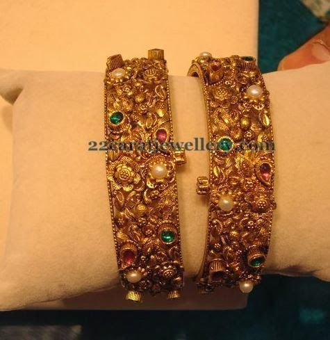 Jewellery Designs: Pearls Embellished Antique Bangles