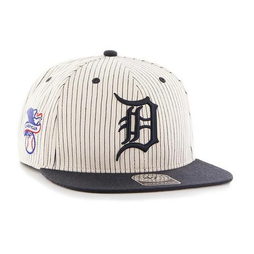 Detroit Tigers '47 Brand Woodside Captain Snapback. This Flat Brim Snapback hat is made from a cotton pinstripe herringbone and wool blend. The cream snapback cap with team color bill features a raise