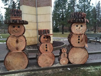 Snow Family made out of logs - Outdoor Snowman