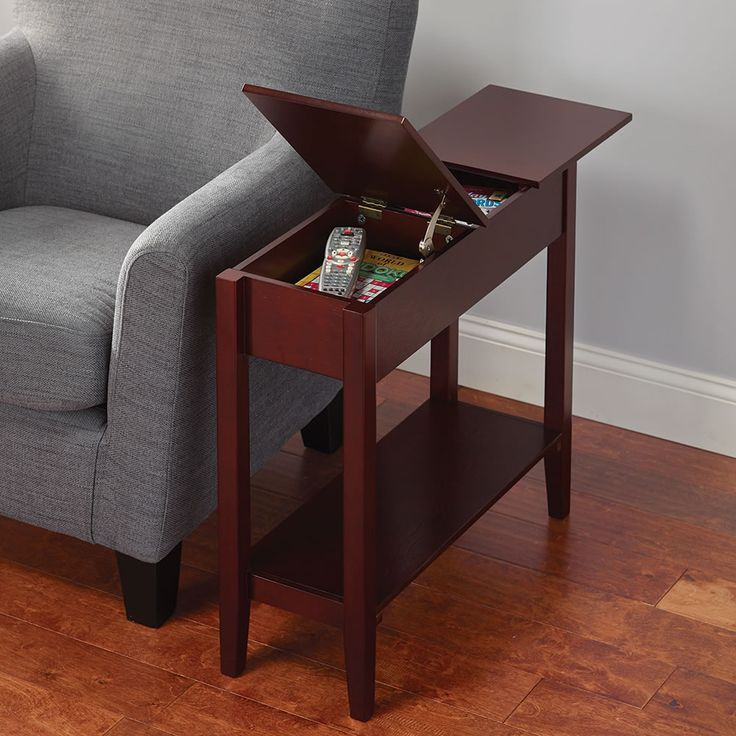The Hidden Storage Side Table - This is the slim-profile side table with hidden storage that keeps clutter at bay, while keeping indispensable items close at hand. Available exclusively from Hammacher Schlemmer, the table has one hinged, lift-up compartment at one end and a sliding lid on the other that provide a convenient place to quickly stow remote controls, eyeglasses, pens, coasters, and other small items. #organize #GetOrganized