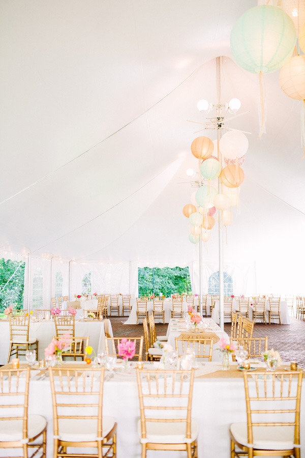 pops of color throughout this tent reception and topped off with fun lantern chandeliers   Photography by lisarigbyphotography.com, Floral Design by petalena.com