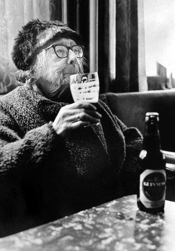 Enjoying a Guinness in the Royal Oak, Bethnal Green, 1970s.