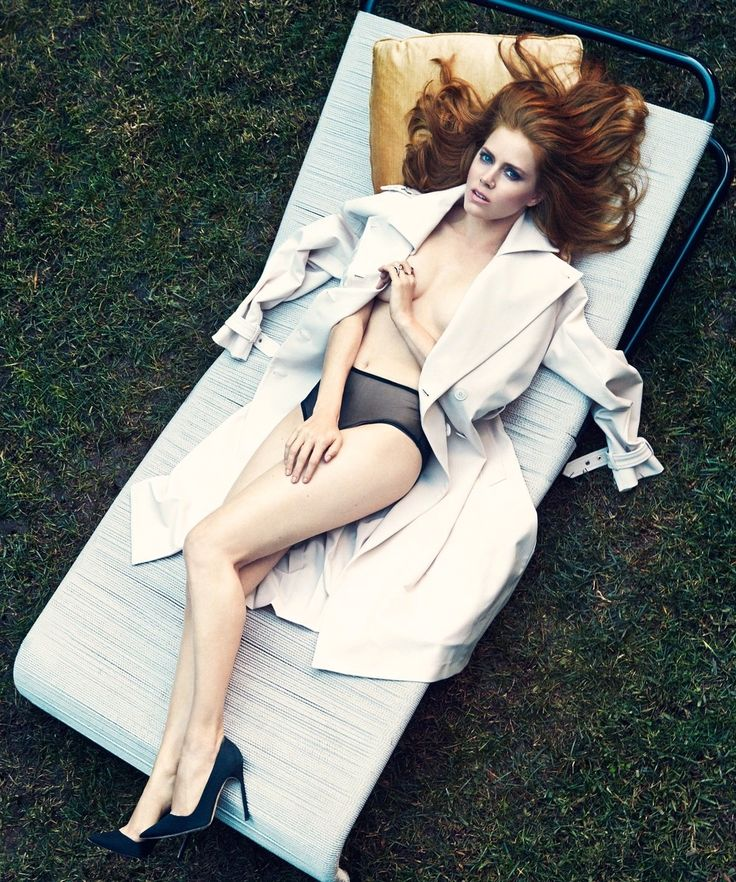 Amy Adams --- How many sunbathe in a coat and high heels?