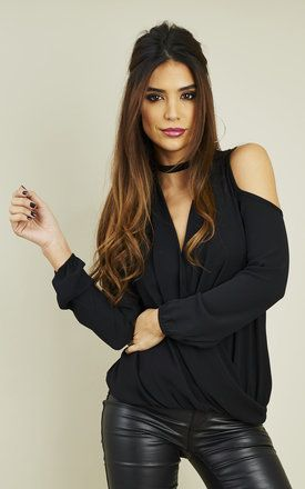 If you're a jean and top kind of gal when you have an important event on or when you party, then this top will be a perfect addition to your collection. With an elegant V neck and cold shoulder detail, it will look sexy and sophisticated.