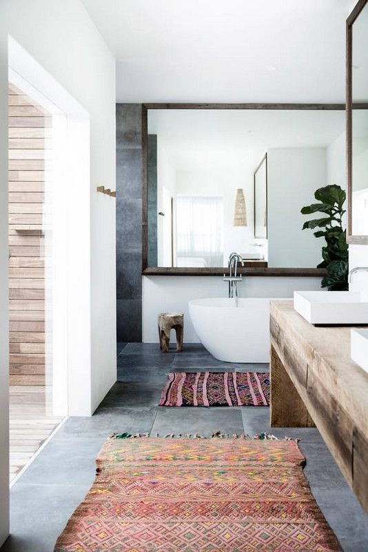 warm up your neutral bathroom with cozy, woven rugs