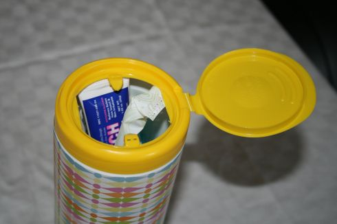 Clorox Wipes container for emergency car kit.. fill up with tylenol, bandaids, sunscreen, wet wipes, and whatever else you might need on the road!