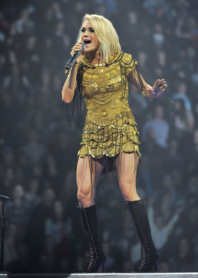 THE GOLD STANDARD! Carrie Underwood, unleashes the Divinity in JANI KHOSLA at the O2 in London. The woman with a golden voice who is on her 'The Storyteller Tour' 2016, chose this gold thread and metal embroidered dress from their 'GODDESS' collection for this very important performance. An absolute knockout.