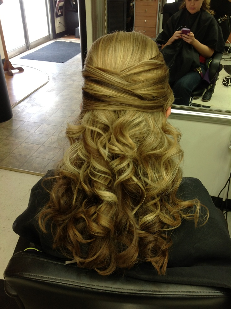 Half up criss crossed formal hairstyle