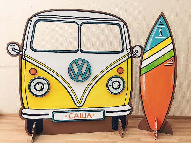 Surfboard and retro volkswagen bus cardboard photoshoot decorations