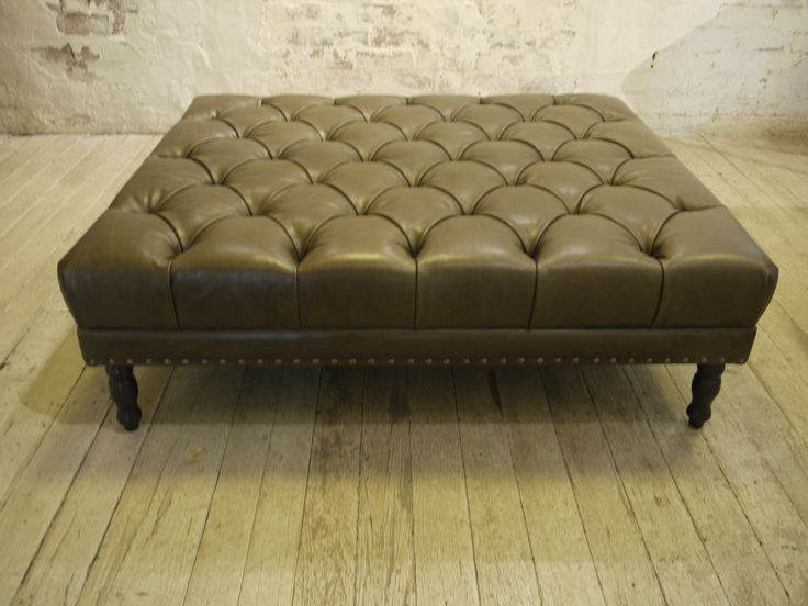 Leather Ottoman in Olive Green.  Deep buttoned, hand studded detail and turned legs.