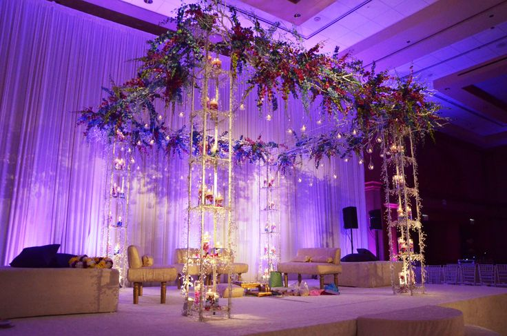 Large grand Mandap design with hanging orchids and light purple