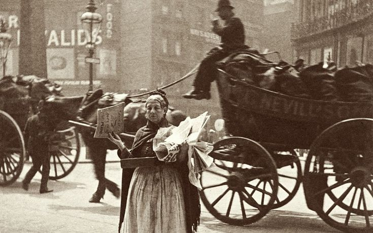 A magazine seller at Ludgate circus photographed by Paul Martin in 1893